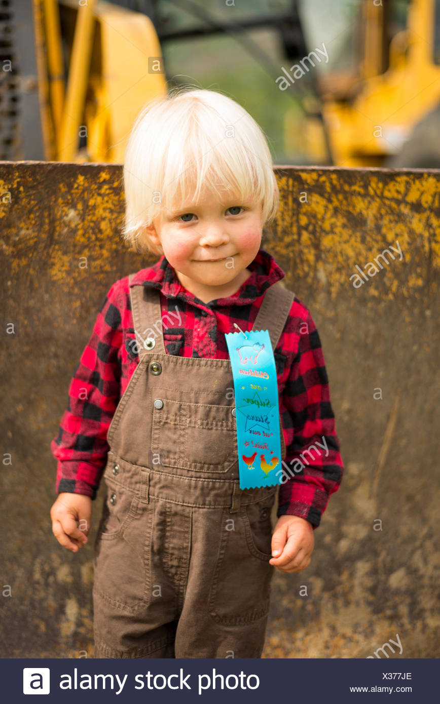 A young boy wins a prize at the Passmore Fall Fair, Castlegar, British Columbia - Stock Image