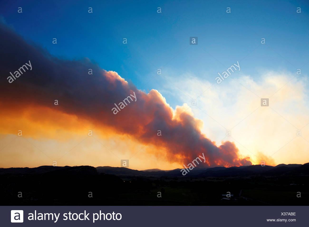 Plume of smoke rises from raging mountain wildfire, Colorado, USA - Stock Image