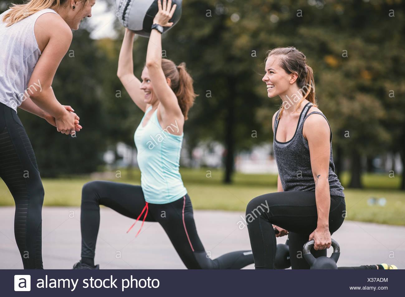 Three women having an outdoor boot camp workout Stock Photo
