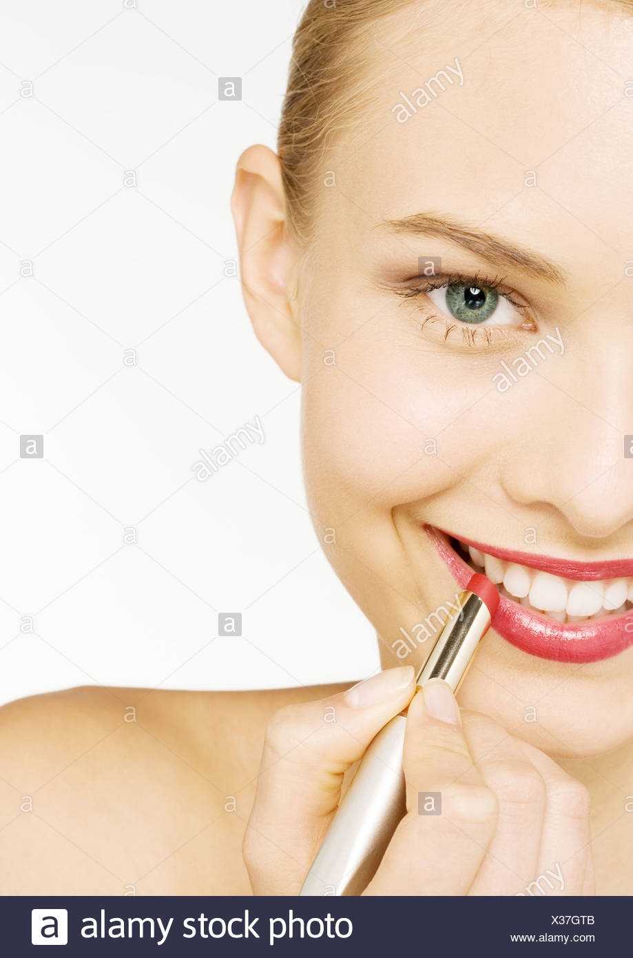 Woman applying lipstick, partial view Stock Photo
