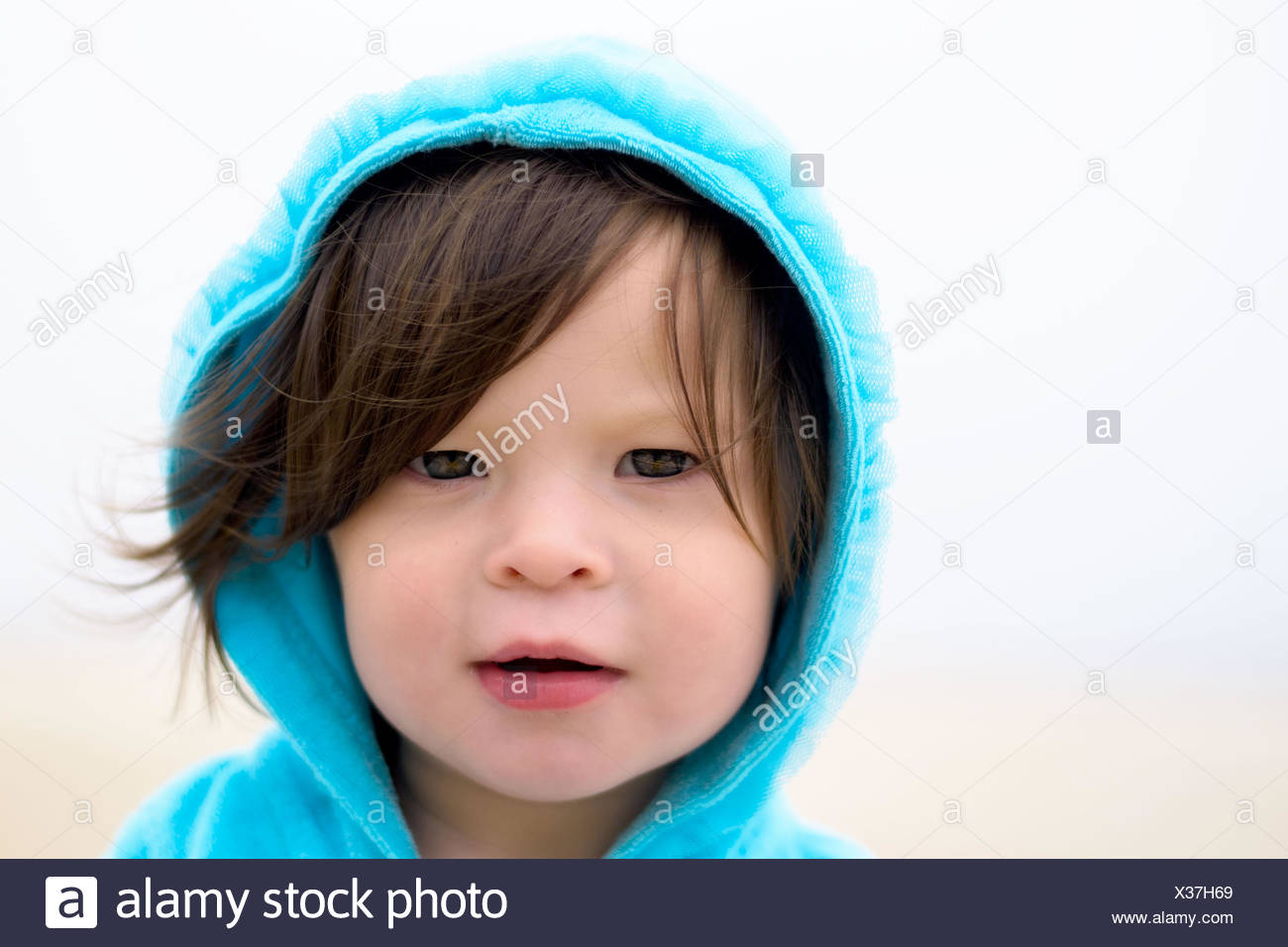 Portrait of girl (2-3 ) wearing hooded shirt - Stock Image