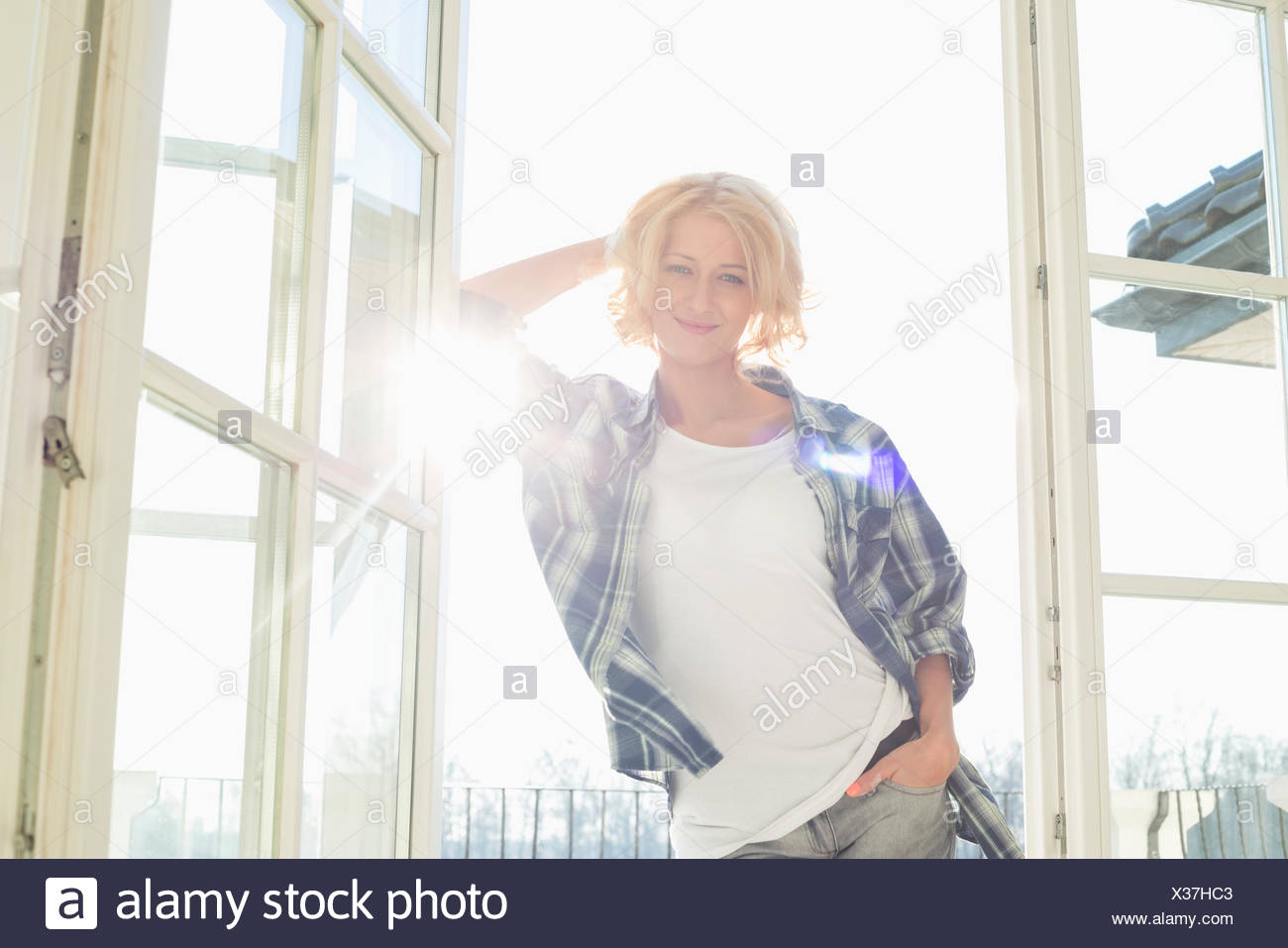 Portrait of beautiful mid-adult woman at home - Stock Image