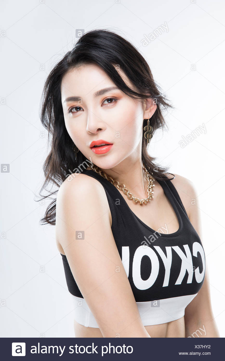 Portrait of young woman in hip-hop style Stock Photo