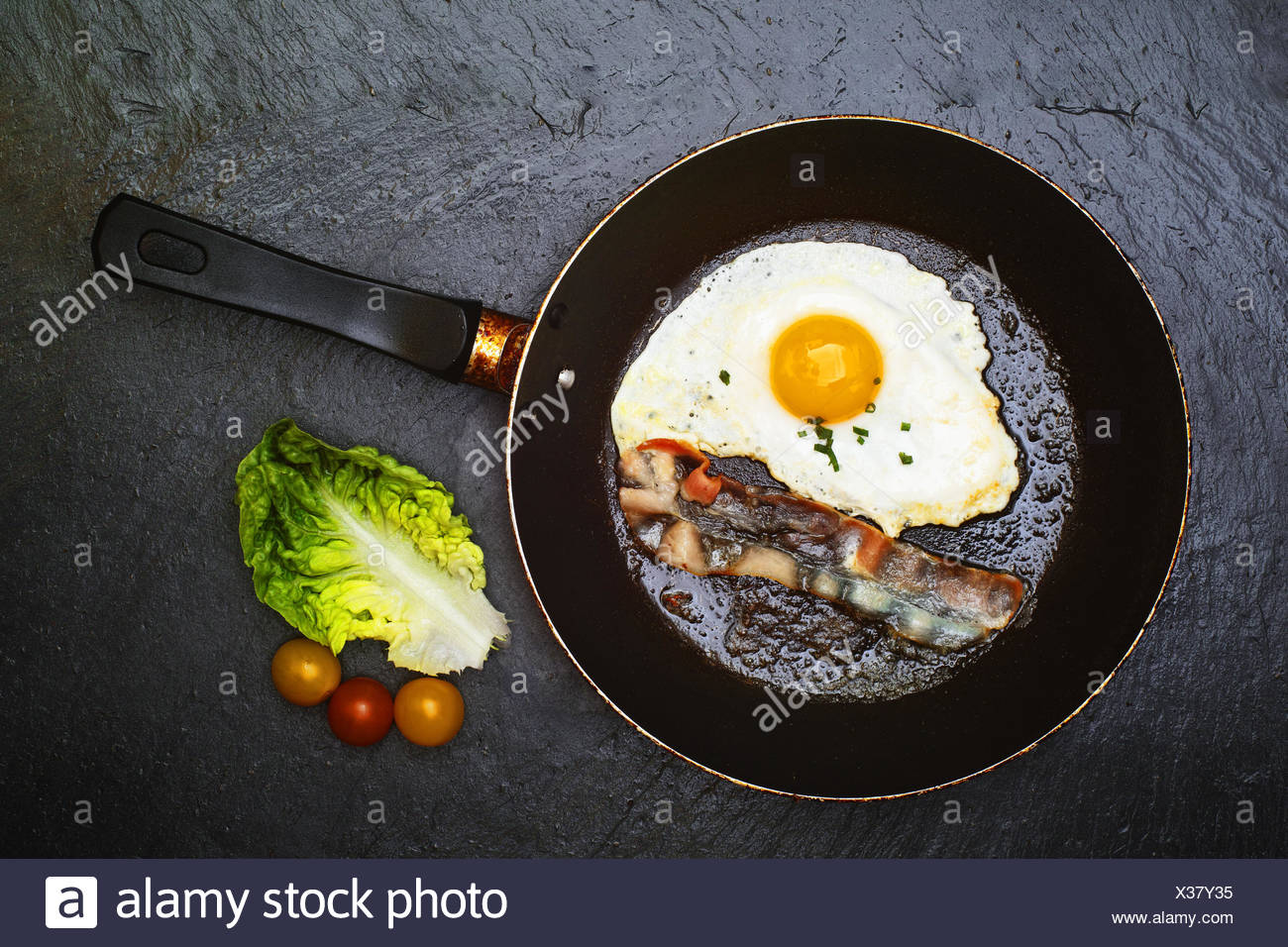 Fried egg with  bacon - Stock Image