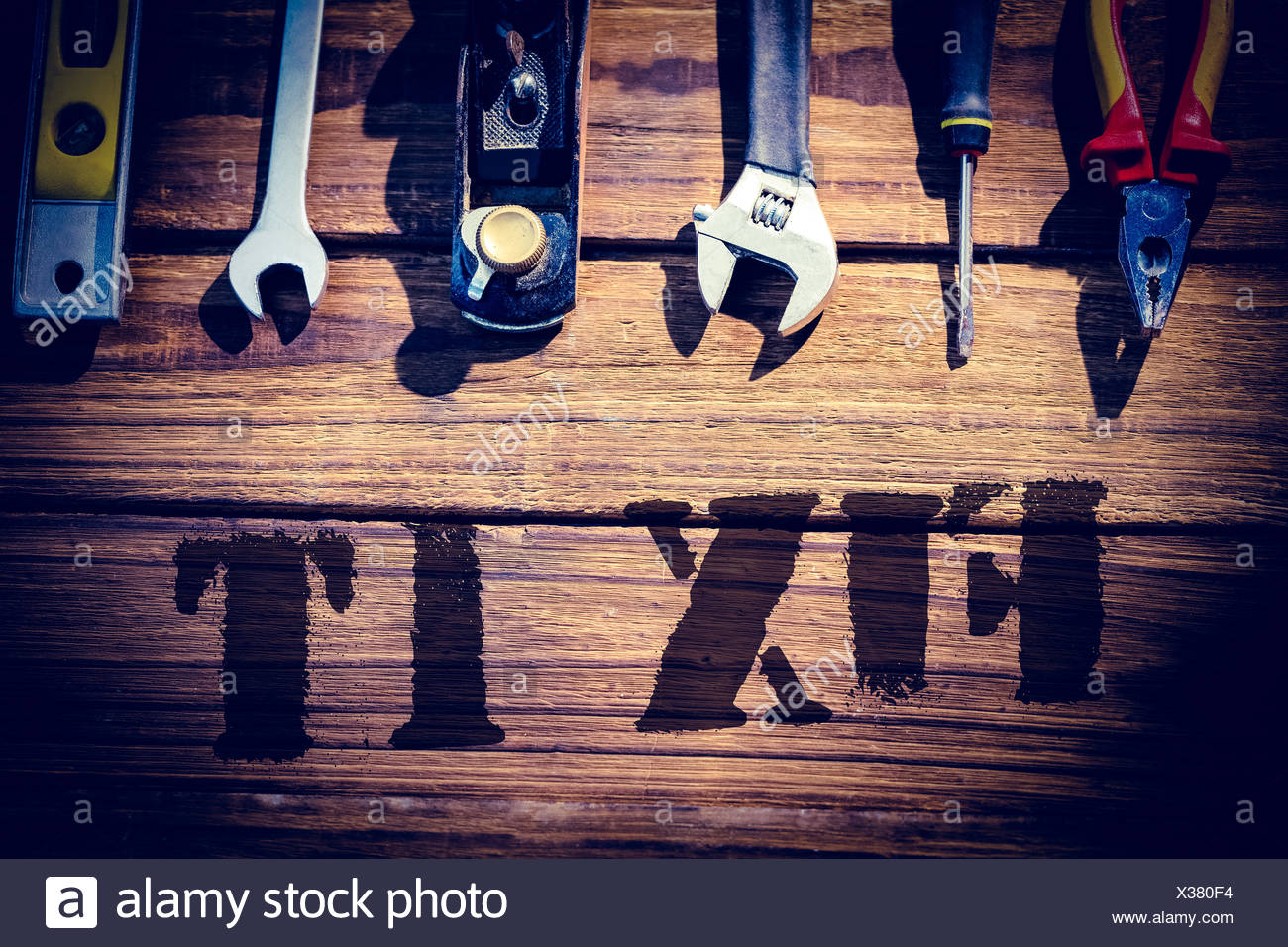 Fix it against desk with tools - Stock Image