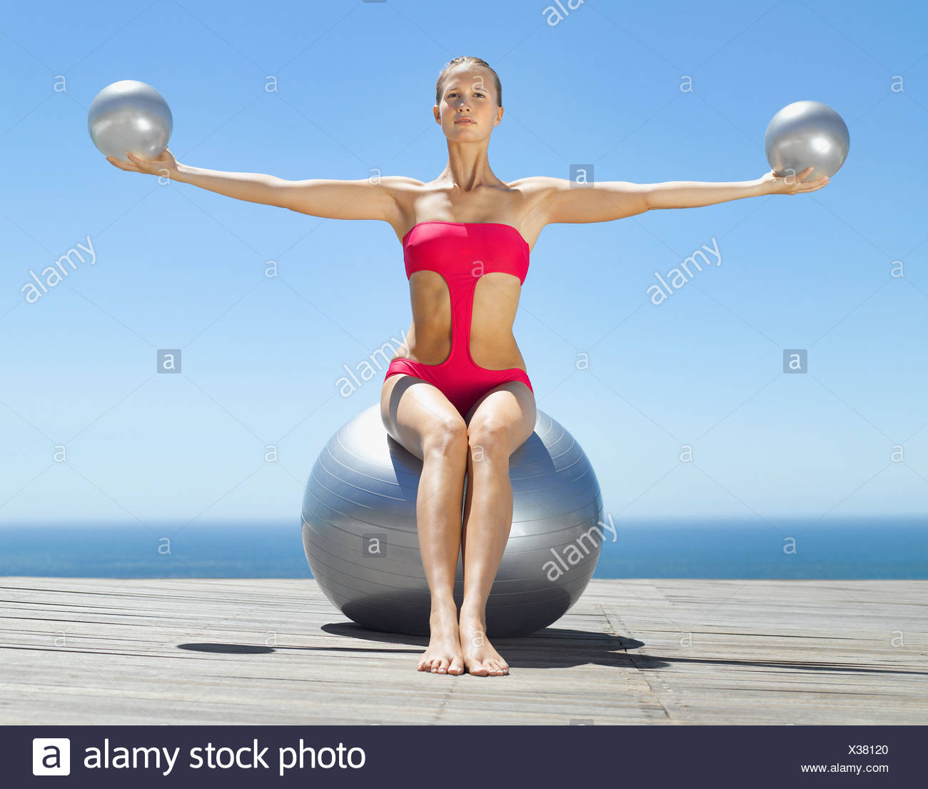 Woman working out with three exercise balls - Stock Image