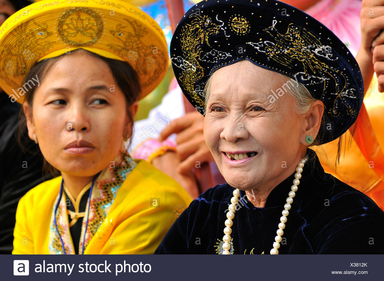 Traditionally dressed women in gorgeous robes at the most important festival of the Cham, Po Nagar temple, Nha Trang, Vietnam - Stock Image