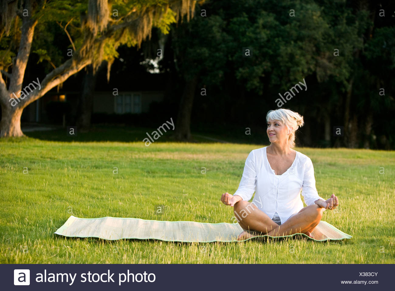 Mature Woman Yoga Alone Stock Photos & Mature Woman Yoga Alone Stock ...