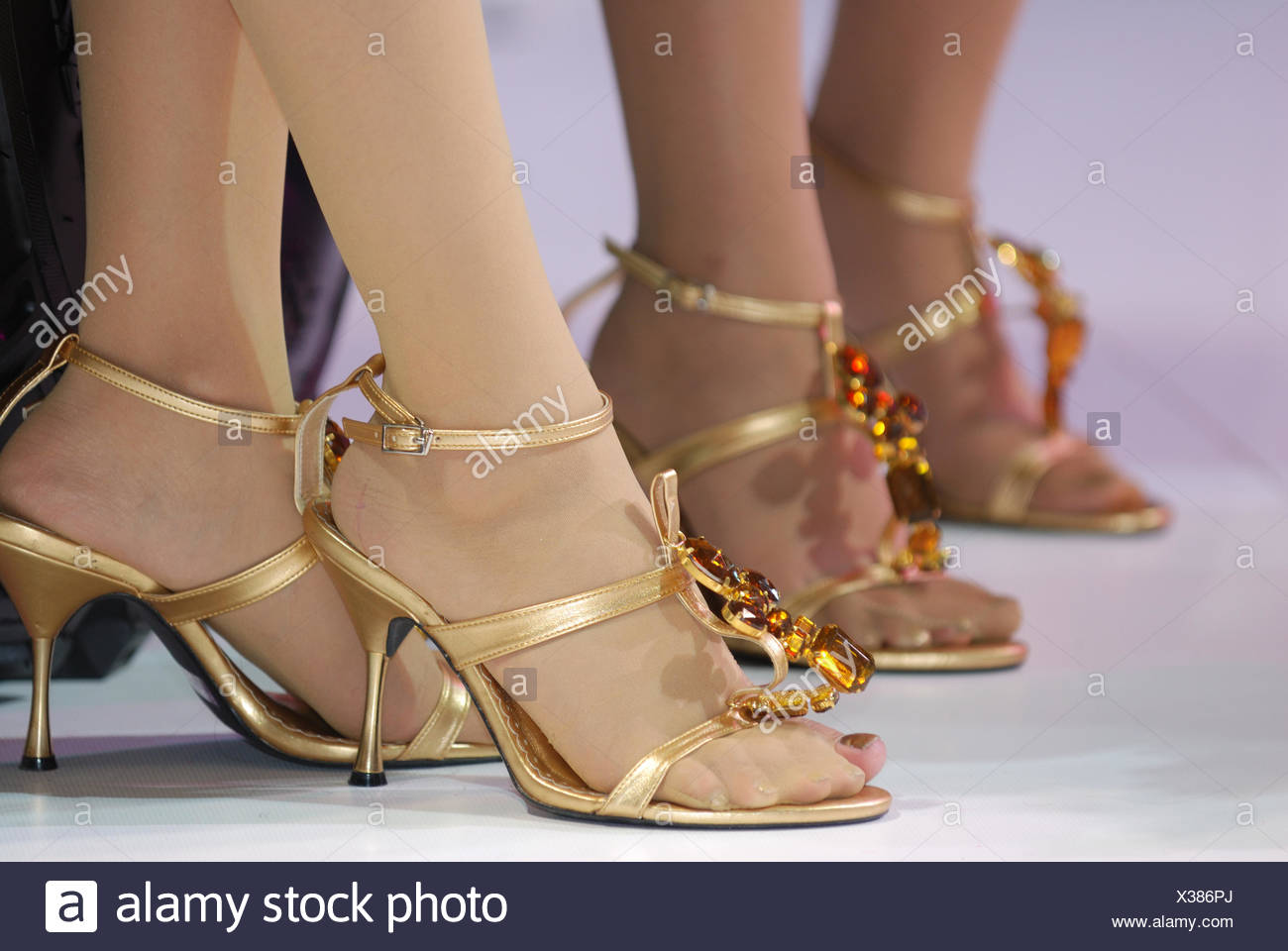 Low Section Of Women Wearing High Heels - Stock Image