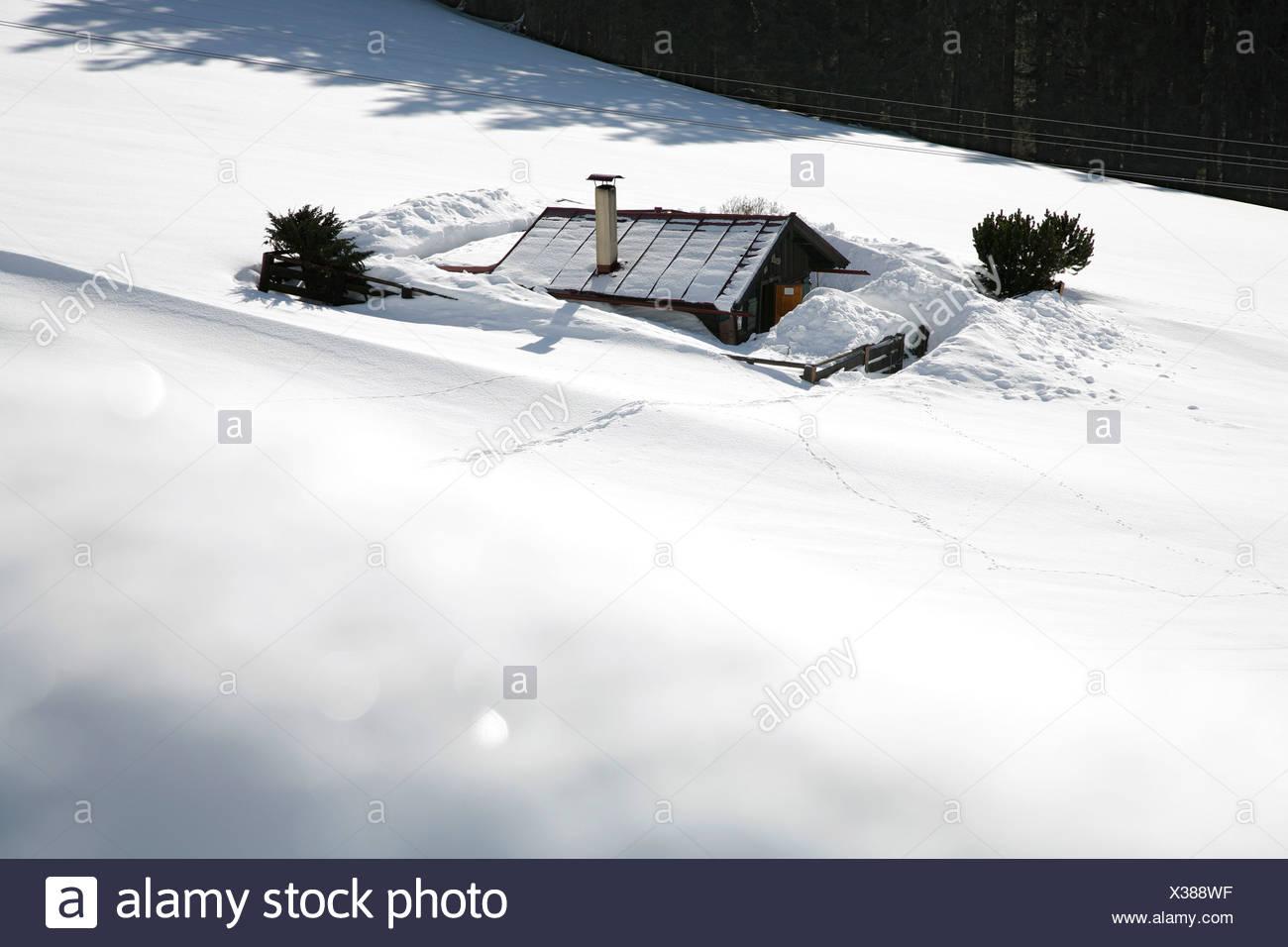Snowed in mountain hut - Stock Image