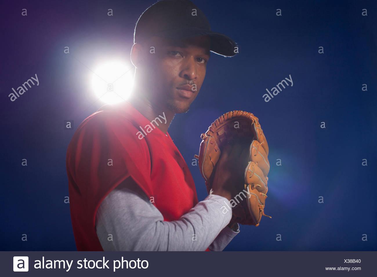 Baseball player holding glove - Stock Image