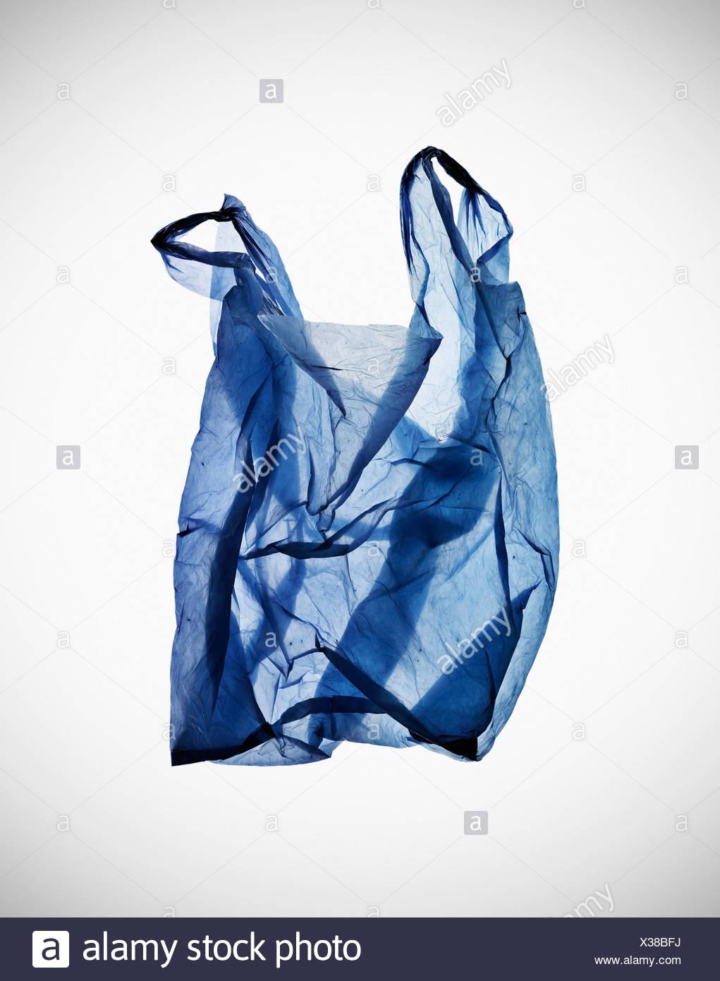 Crumpled blue plastic bag on table Stock Photo