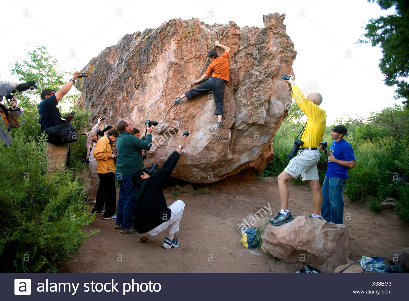 Photographers take pictures of man climbing, Colorado Springs - Stock Image