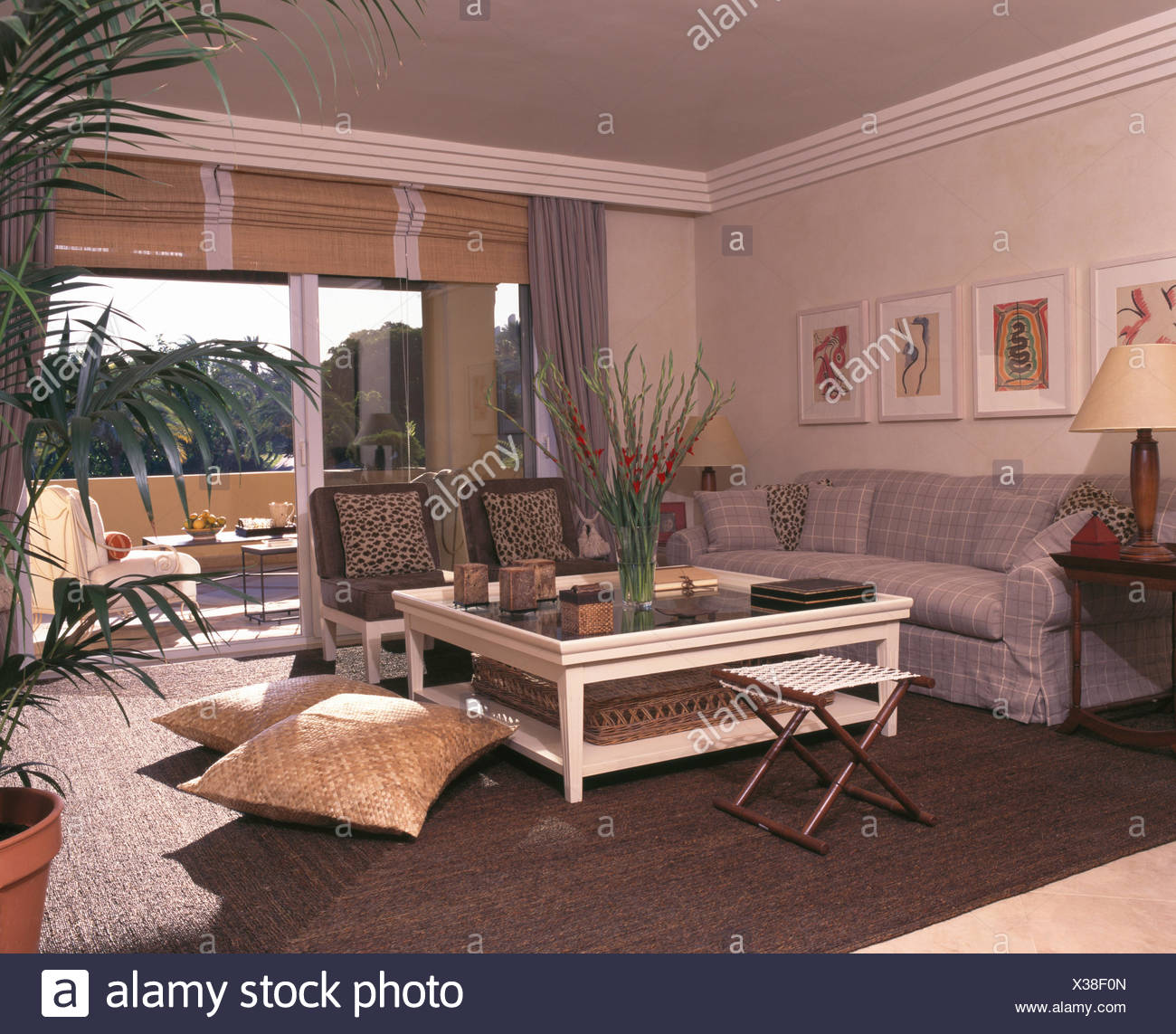 White Glass Topped Coffee Table In Spanish Coastal Living Room With