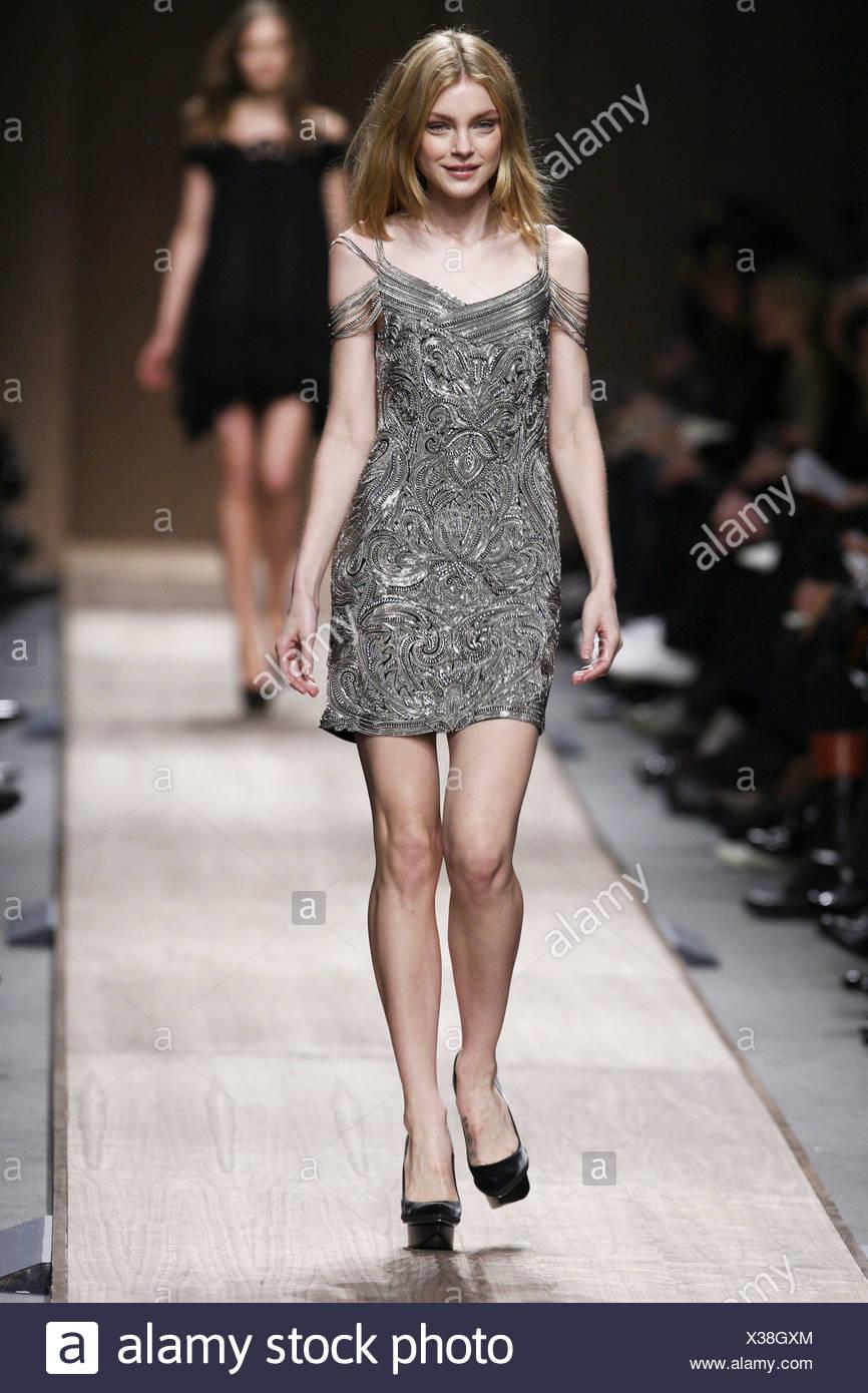 ecb2a52022835 Stella McCartney Paris Ready to Wear Autumn Winter Model wearing a light  grey metallic look mini