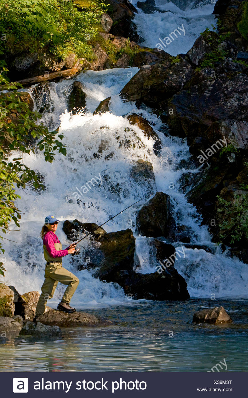 Woman spin fishing for salmon, Big River Lakes in Redoubt Bay State Critical Habitat Area, Southcentral Alaska - Stock Image