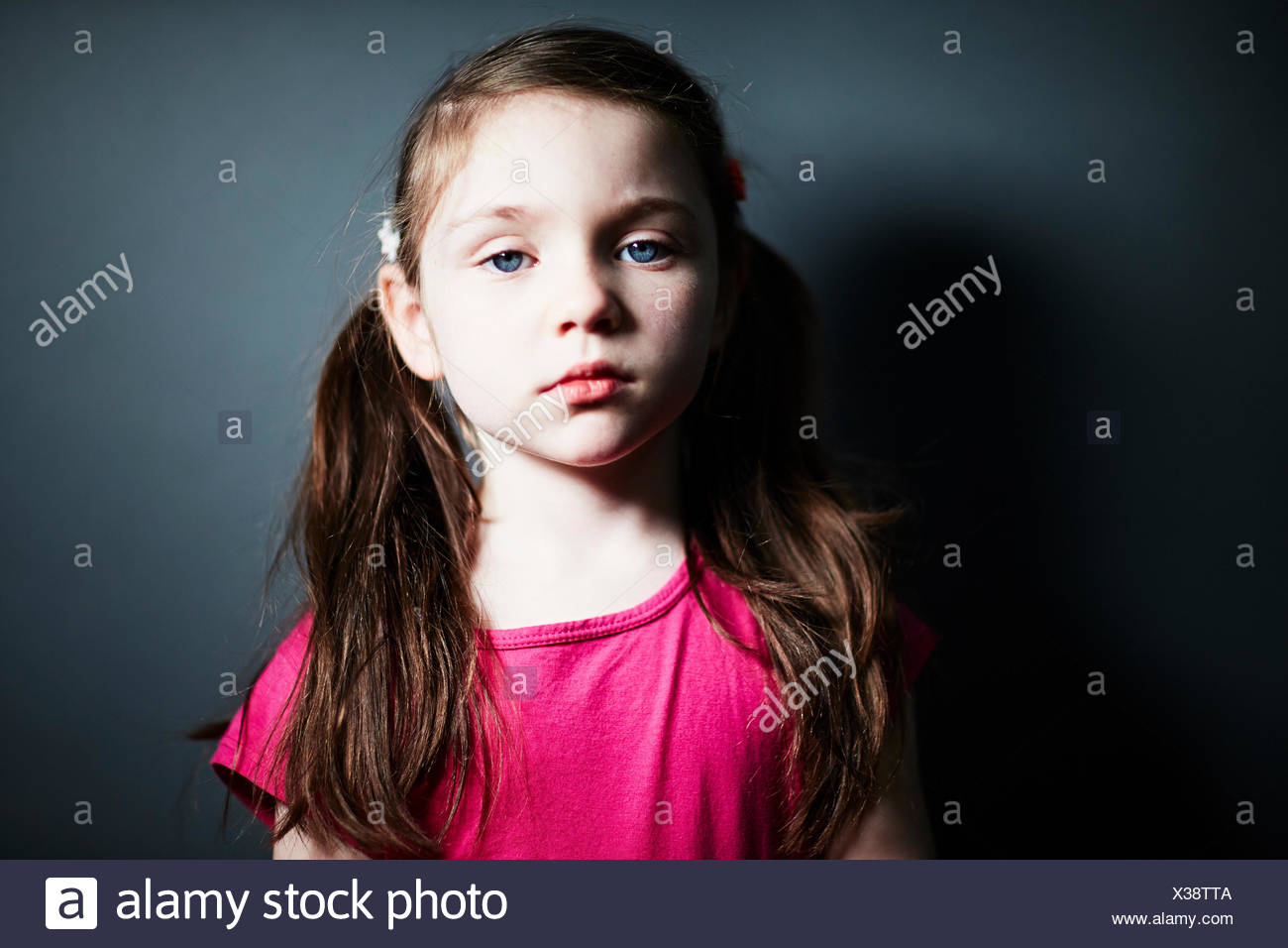 Girl with pigtails - Stock Image