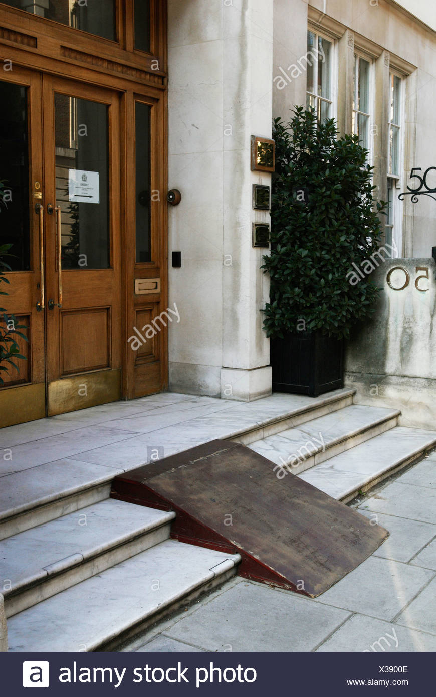 Ramp on steps to provide wheelchair access - Stock Image