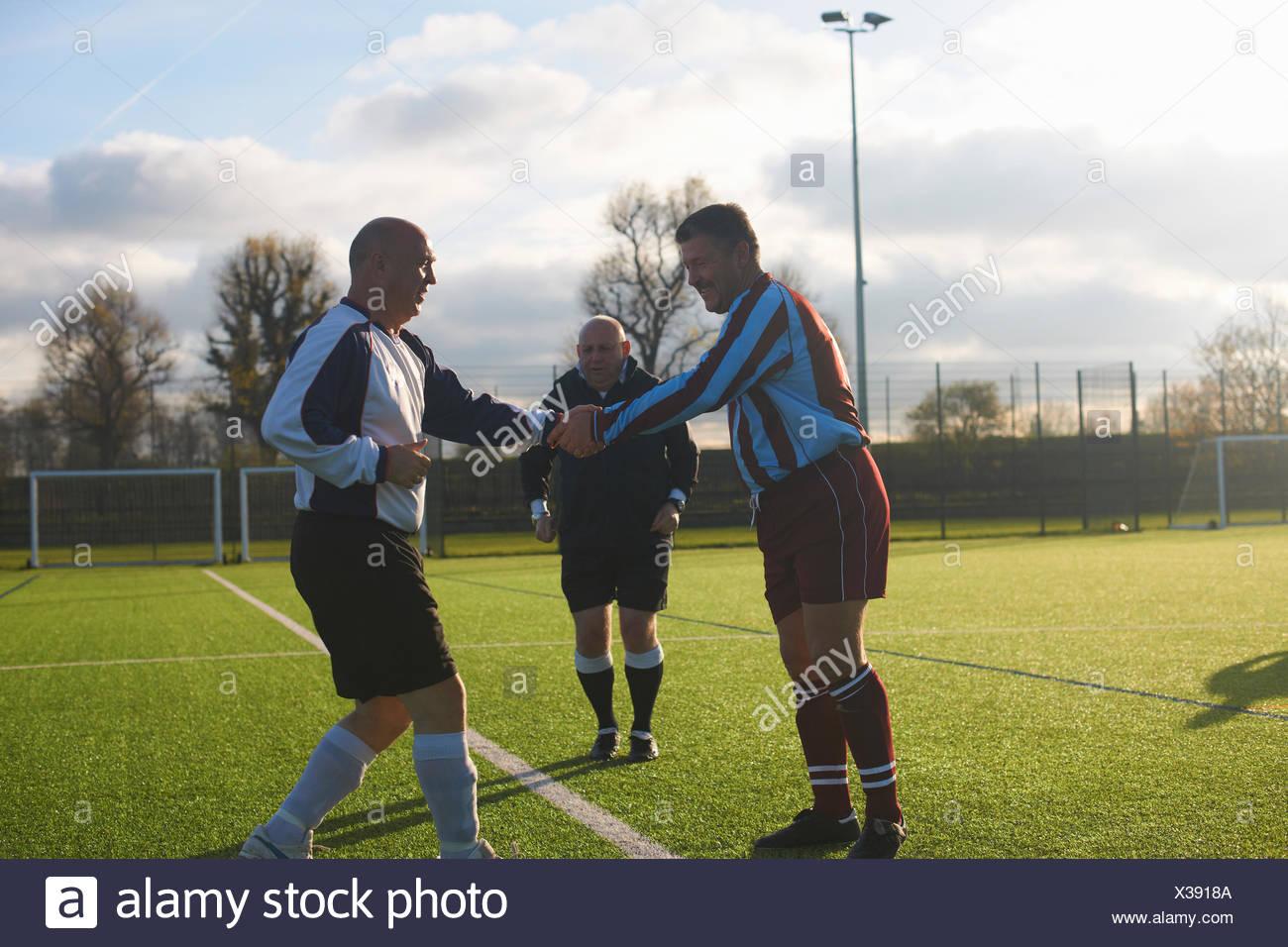 Football players starting game - Stock Image