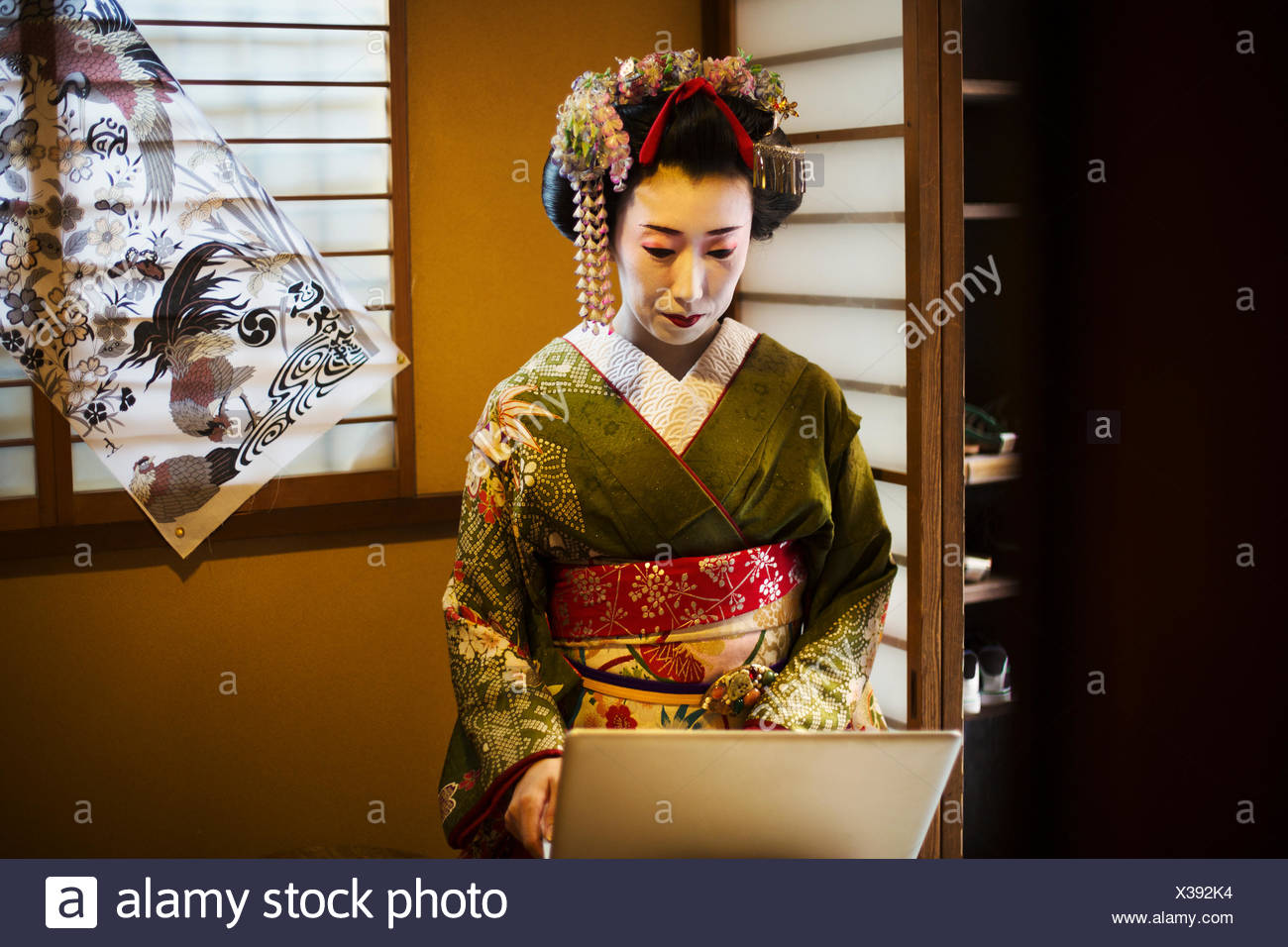 A Woman Dressed In The Traditional Geisha Style Wearing Kimono And Obi With