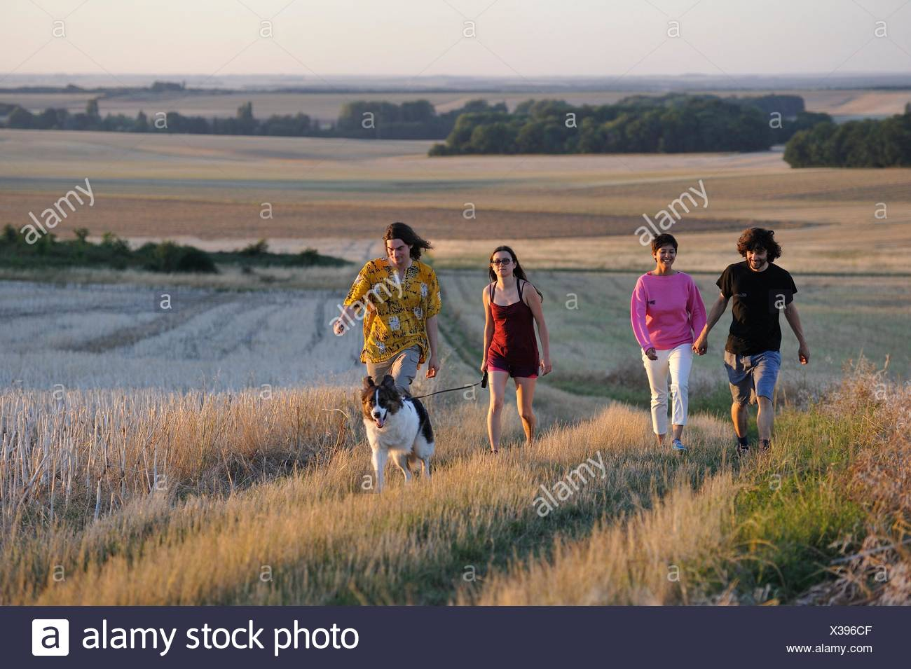 Young people walking around Mittainville, Yvelines department, Ile-de-France region, France, Europe. - Stock Image