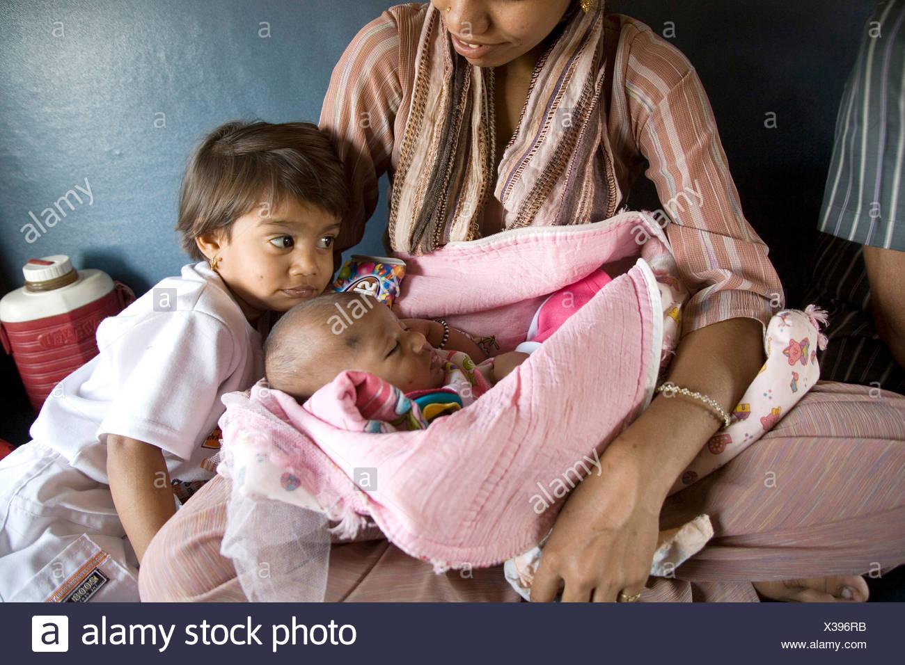 South Asian Indian Woman With Two Children Traveling In Train Bombay Mumbai Maharashtra India Stock Photo Alamy