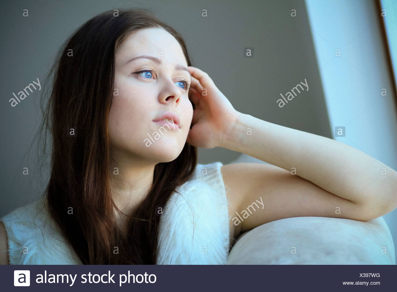 Woman with brown hair, day dreaming, Copenhagen, Denmark - Stock Image