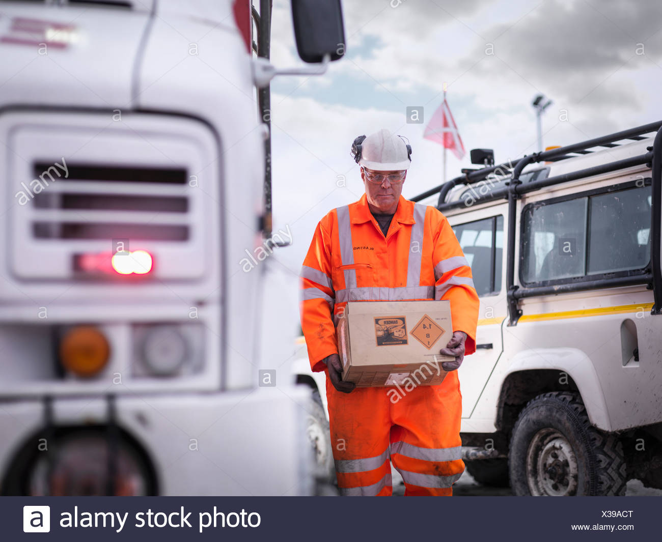 Explosives expert carrying box in surface coal mine - Stock Image