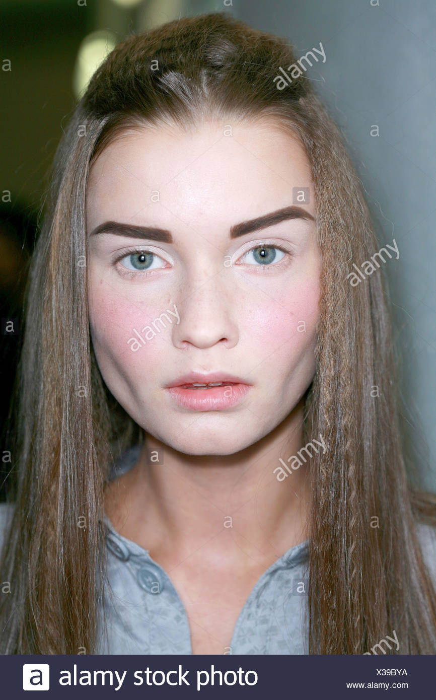 Chanel Backstage Paris Ready to Wear Autumn Winter Model long blonde crimmped hair half off face defined eye brows looking - Stock Image