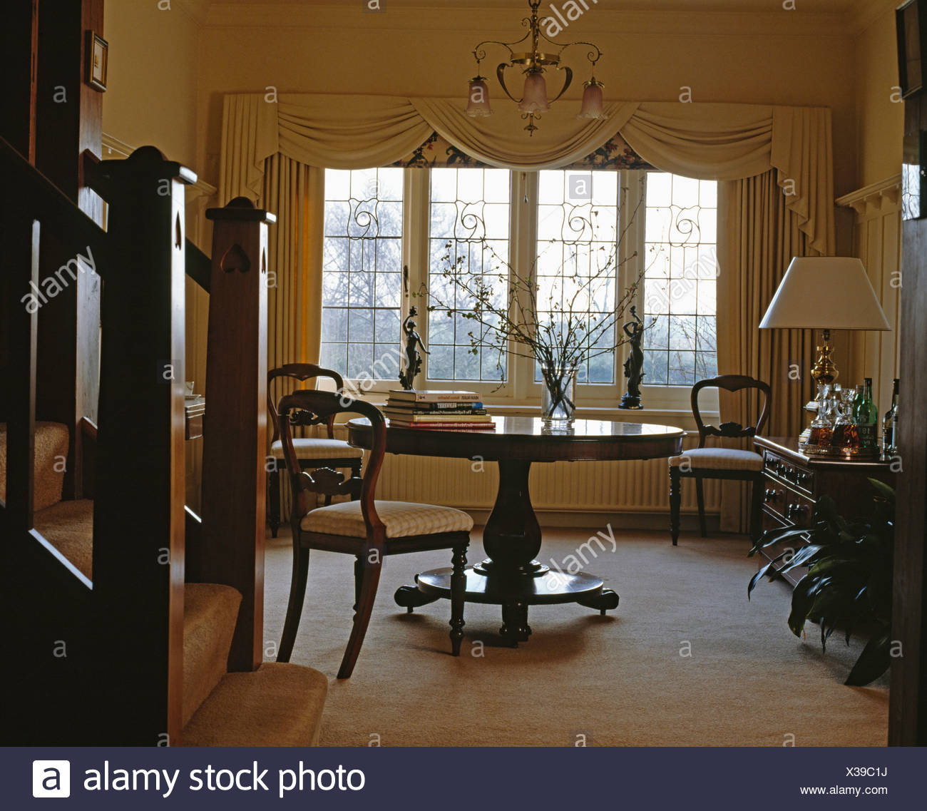 Victorian Table And Chairs In Country Hall Dining Room With Cream Carpet And Window With Cream Swagged Curtains Stock Photo Alamy