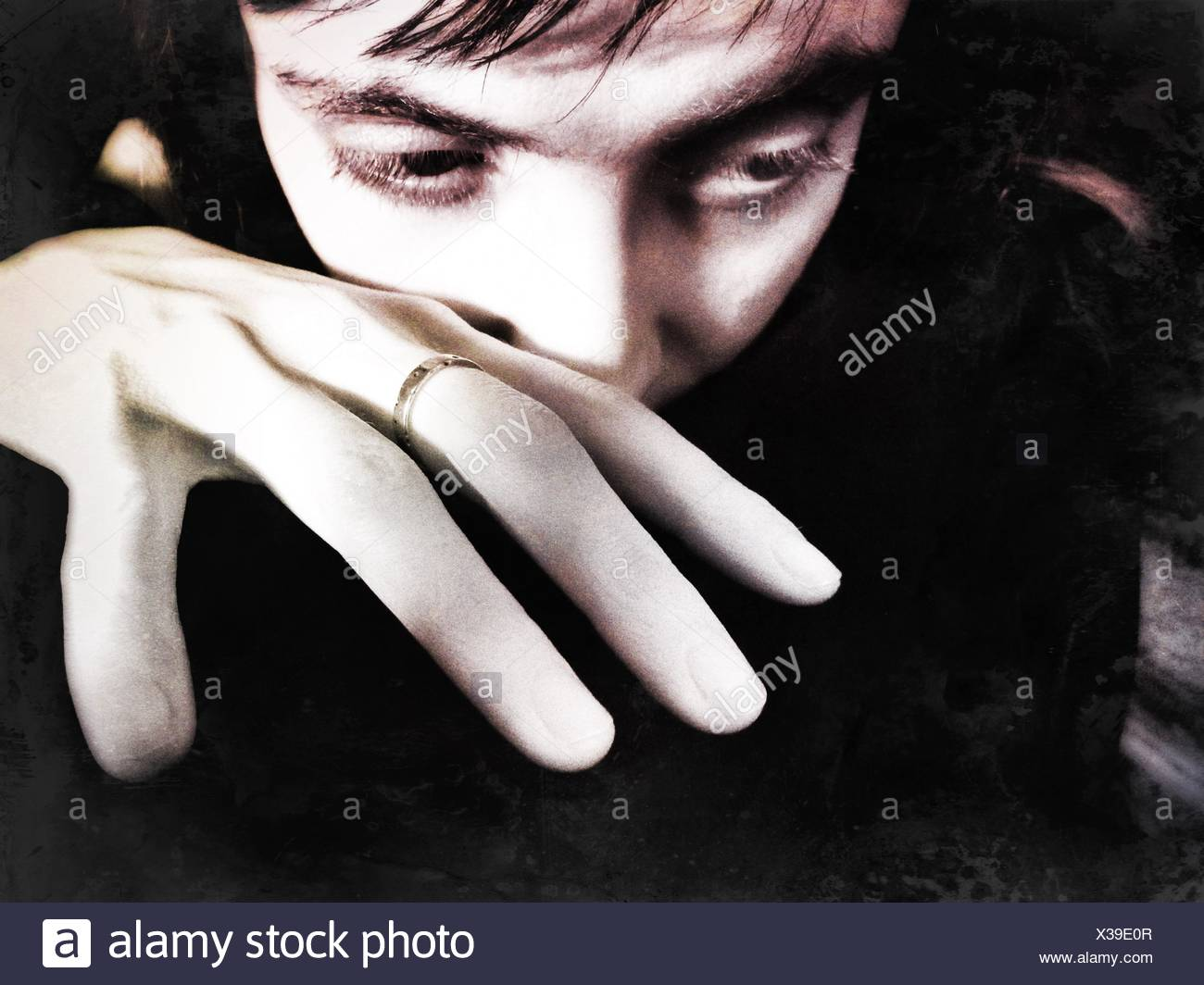 Close-Up Of Woman Looking Down In House - Stock Image