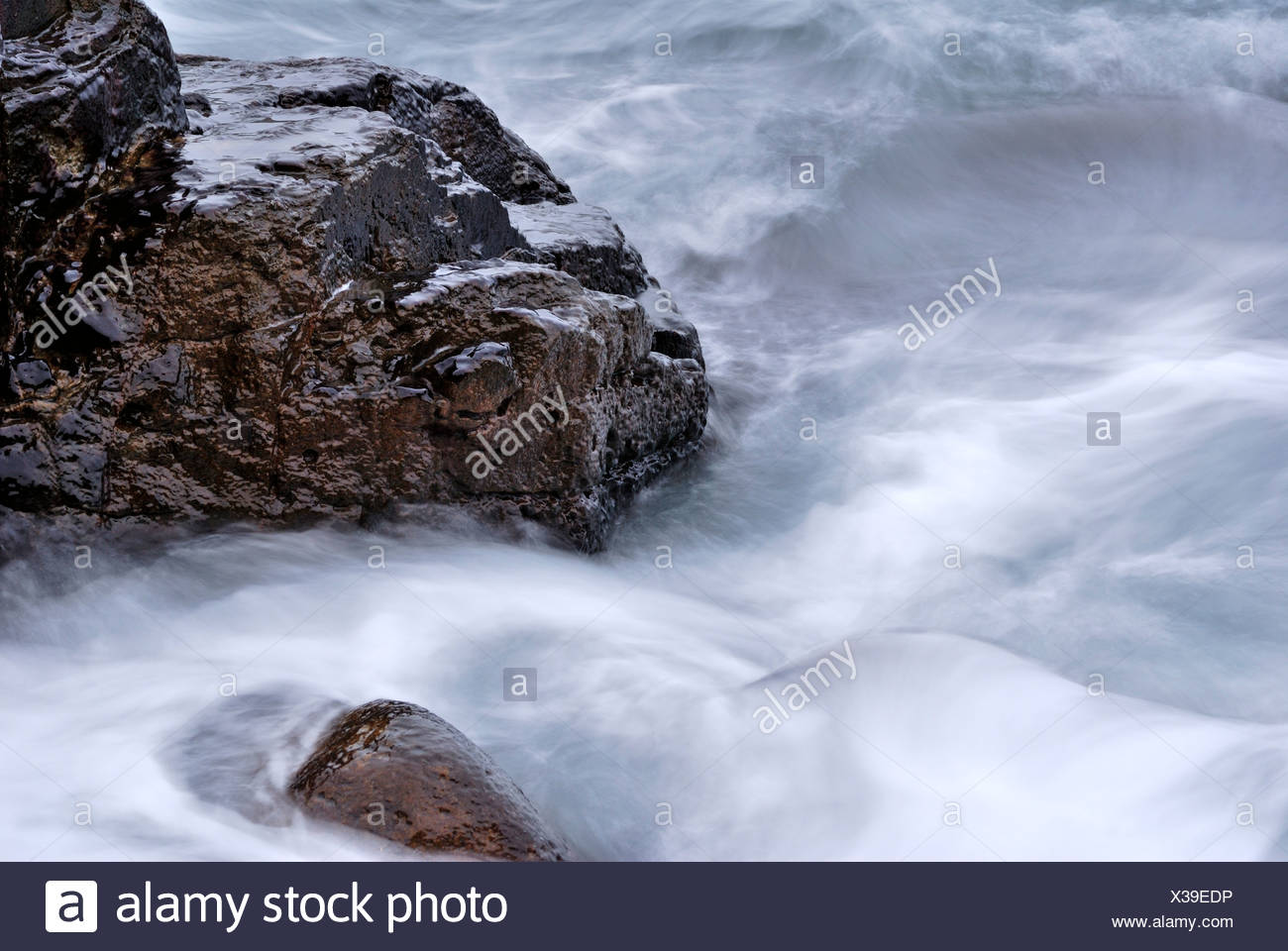 rocks in black sea water near blue bay on crimea Stock Photo