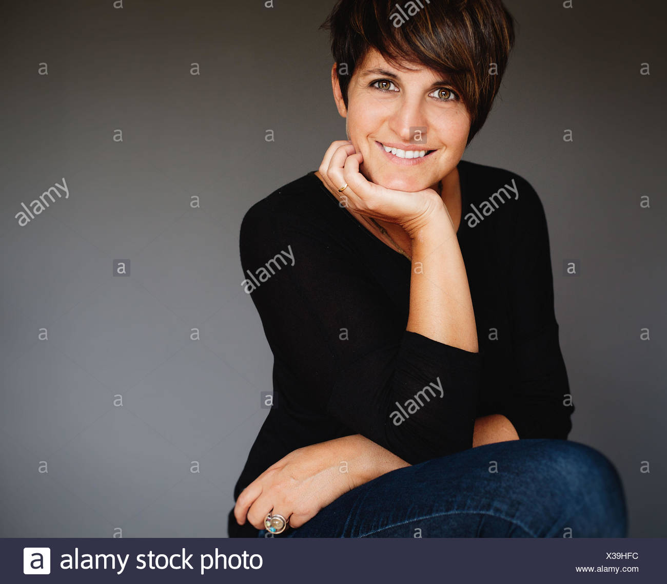 Portrait of smiling middle aged woman - Stock Image