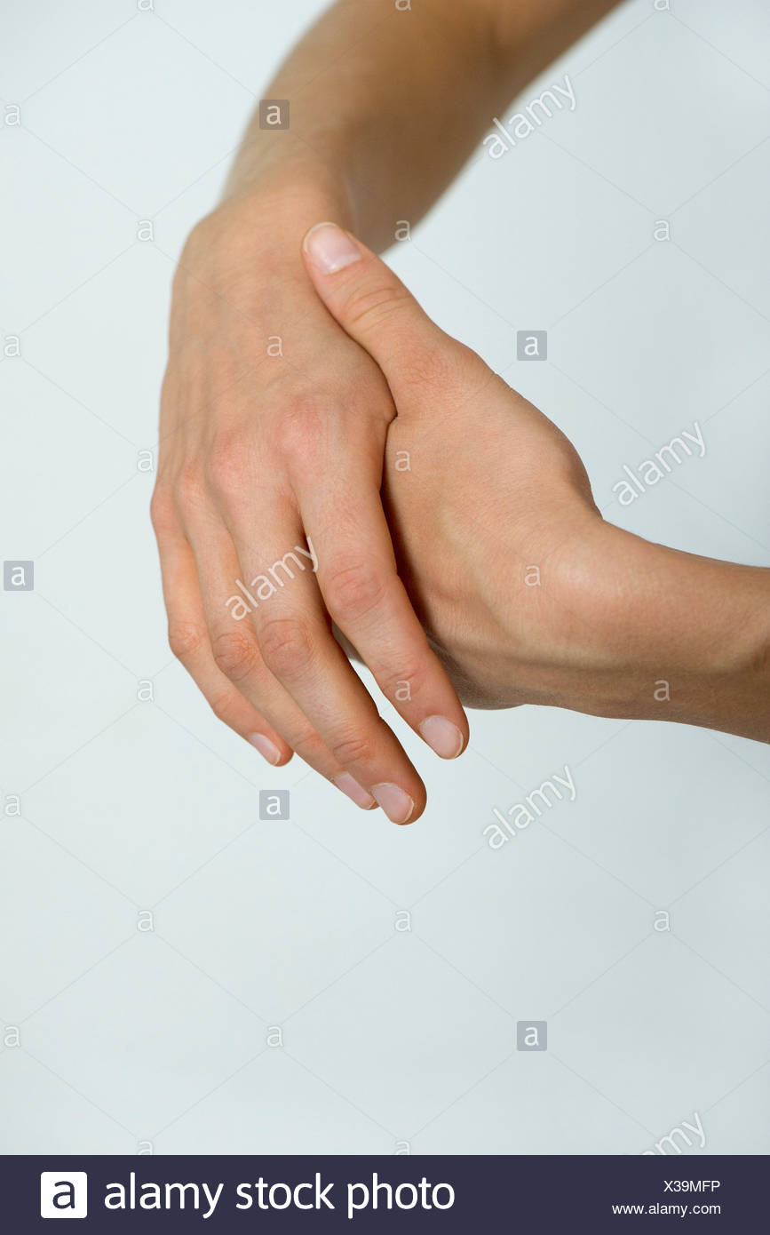 Rubbing hands, cropped - Stock Image