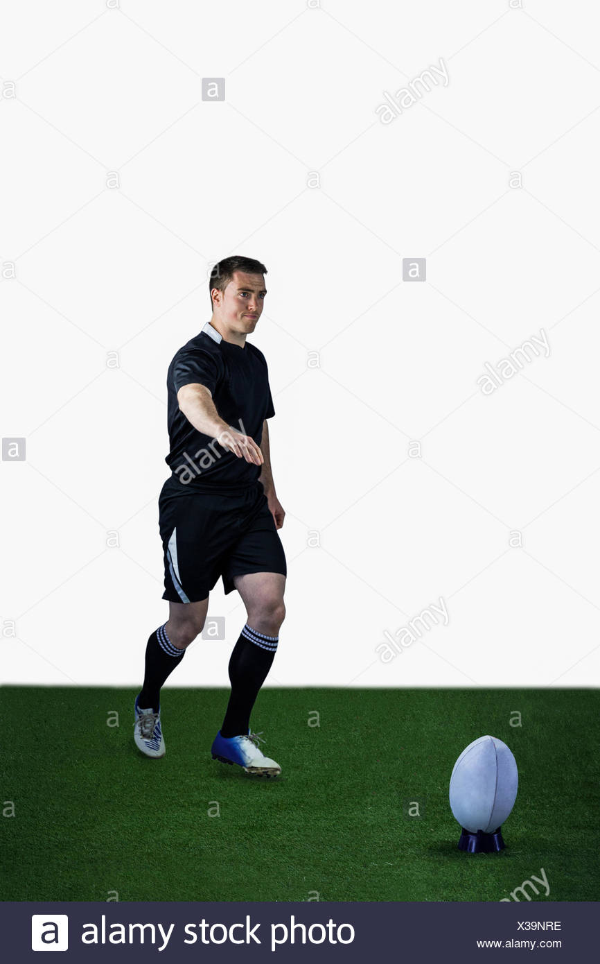 Rugby player doing a drop kick Stock Photo: 277424546 - Alamy