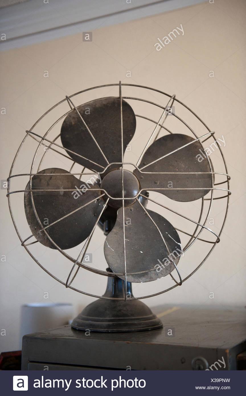 An antique fan. - Stock Image