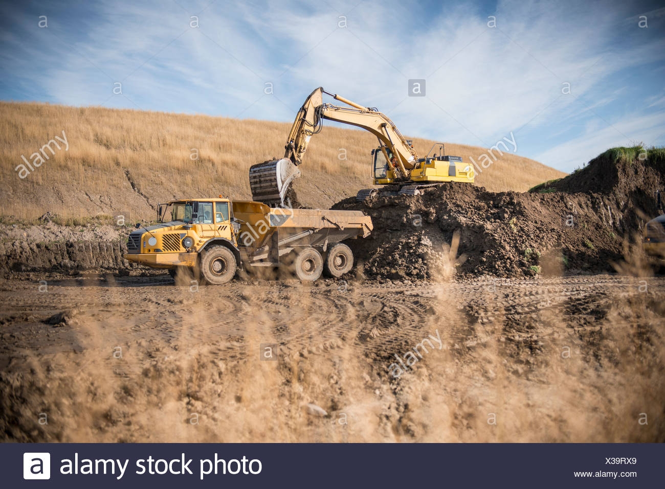 Excavator working at surface coal mine - Stock Image