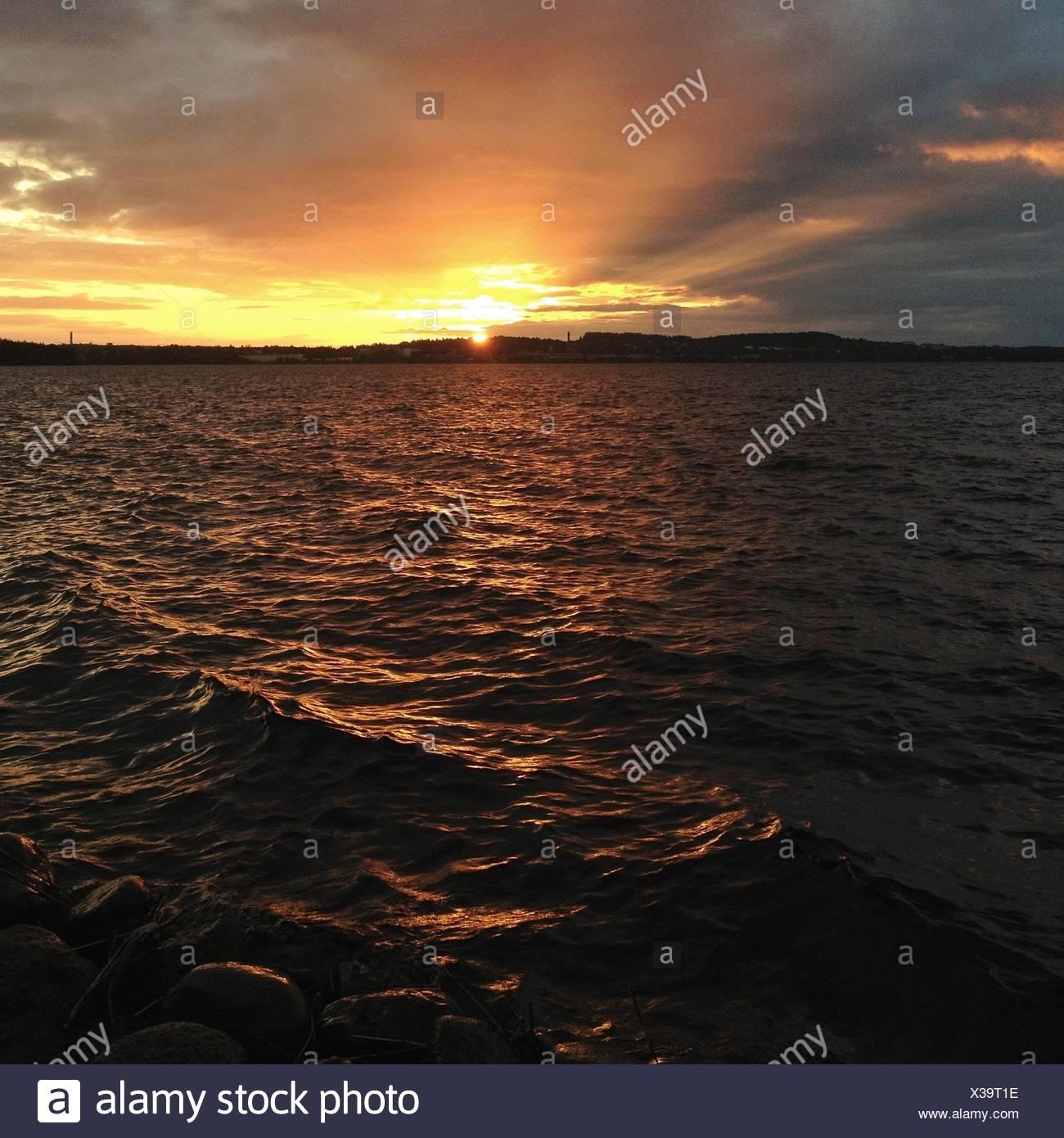 Sunset across lake - Stock Image
