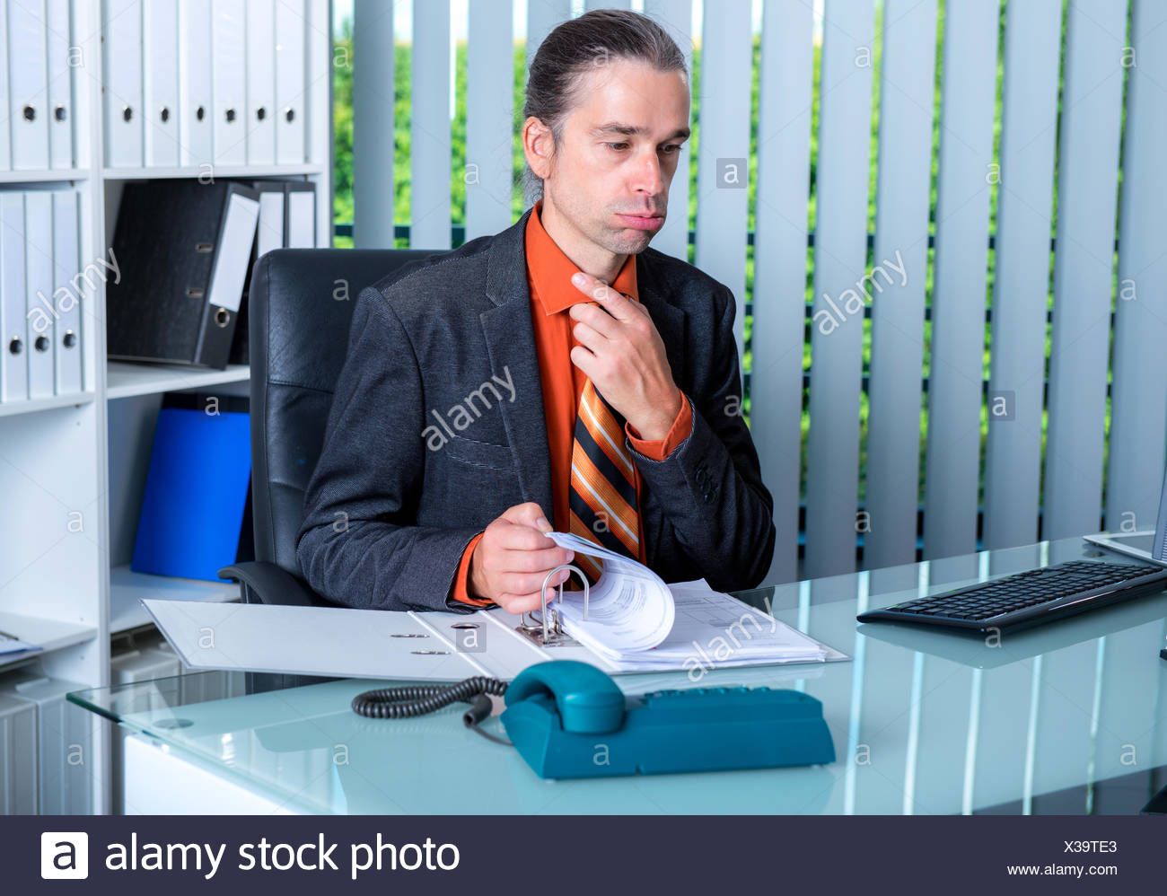 business man at his desk in summerly hot office - Stock Image