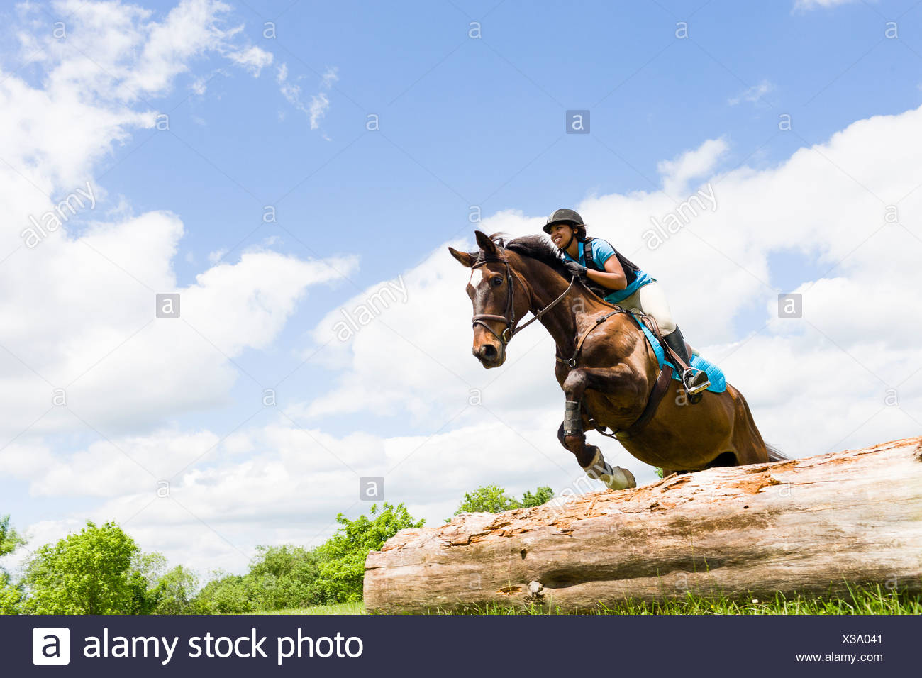 Horse rider jumping on horse - Stock Image