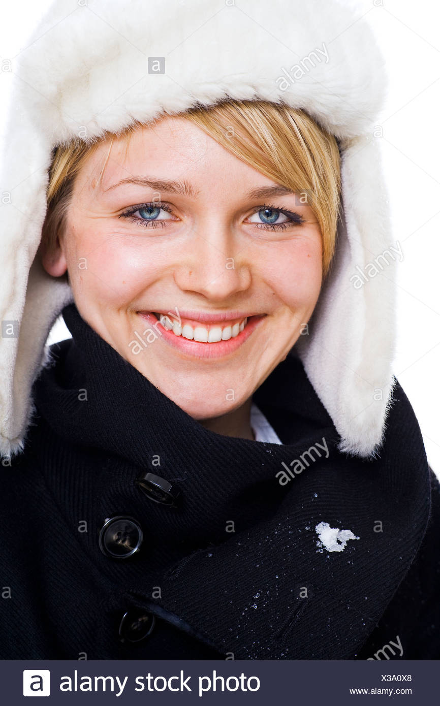 Woman in warm clothing, smiling - Stock Image