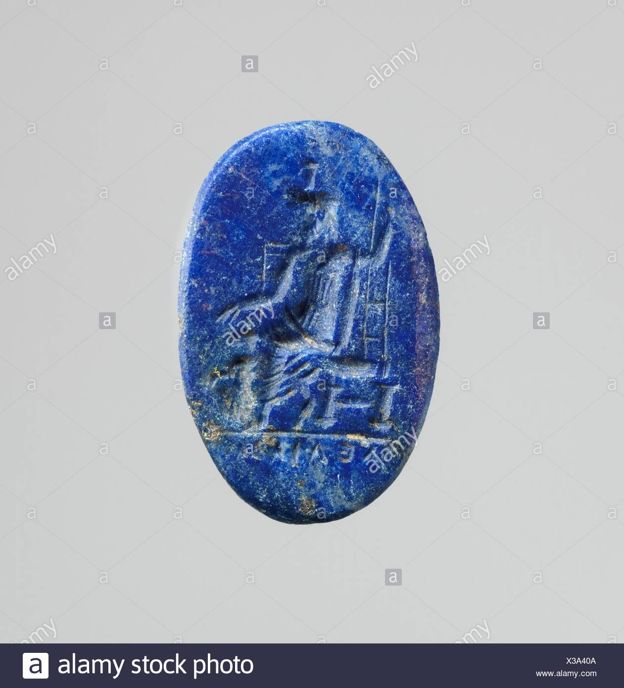 Lapis lazuli intaglio: Serapis enthroned. Period: Imperial; Date: 2nd century A.D; Culture: Roman; Medium: Lapis lazuli; Dimensions: Other: 5/8 x 3/8 - Stock Image