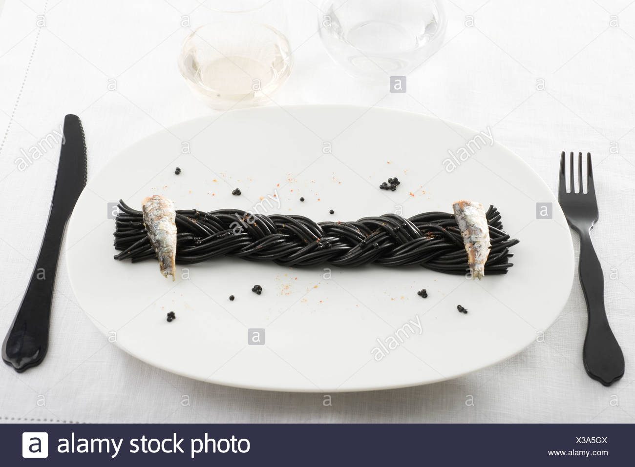 Black spaghetti with sardines and Espelette pepper Stock Photo
