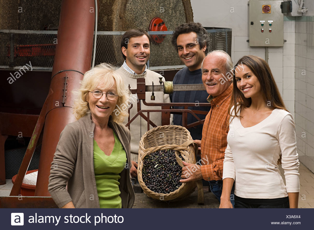 People by olive press - Stock Image