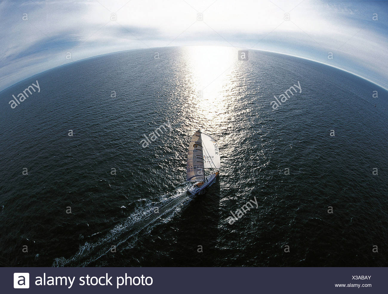 Ellen MacArthur heading towards the horizon on-board her Open 60 Kingfisher, in which she finished 2nd in the singlehanded Vende - Stock Image
