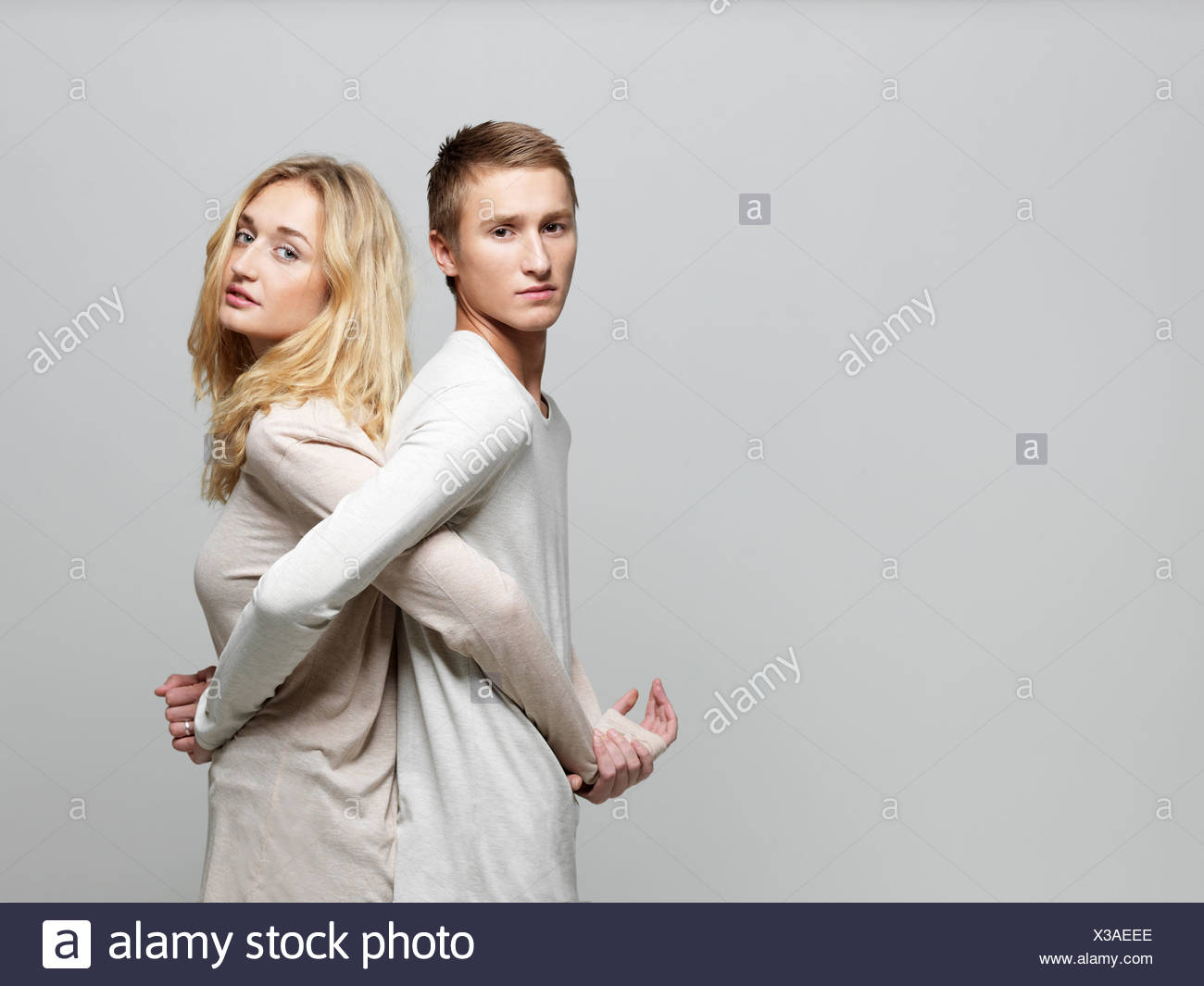Young couple back to back - Stock Image