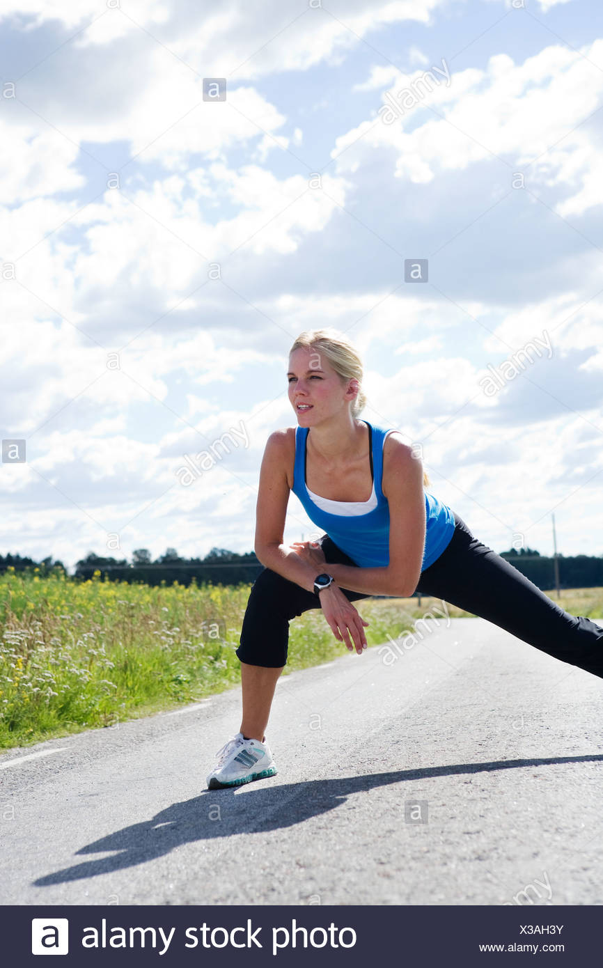 A woman doing stretching exercises Sweden. - Stock Image