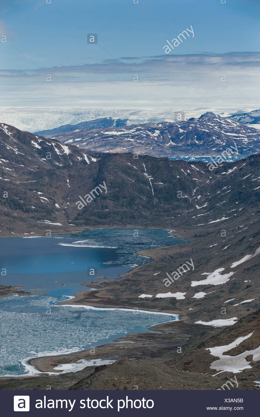 Facing inland towards the ice sheet, view from the mountain of Tasiilaq, also known as Ammassalik, East Greenland, Greenland - Stock Image