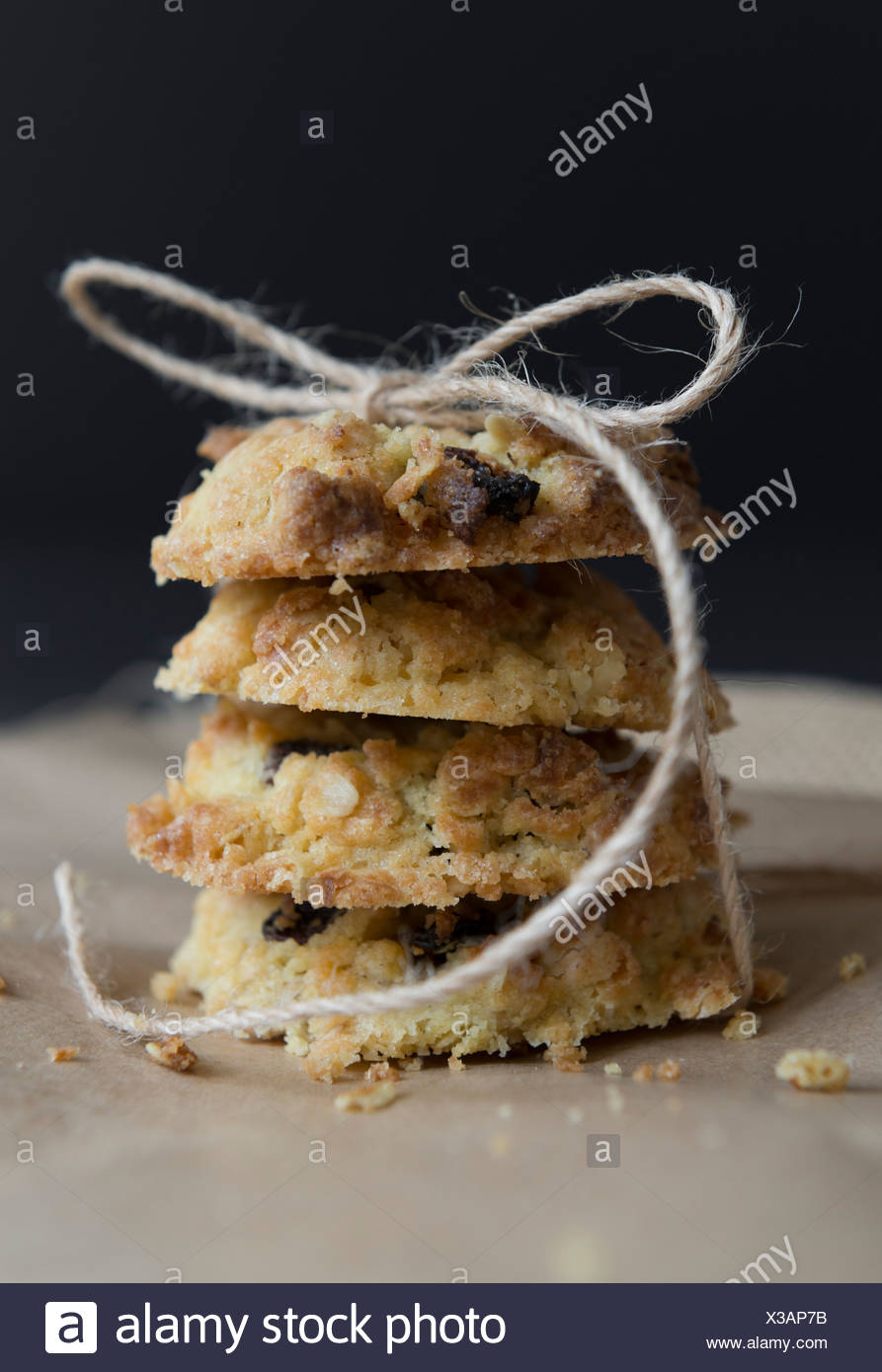 Sultana and oat cookies, homemade and tied ith string. - Stock Image