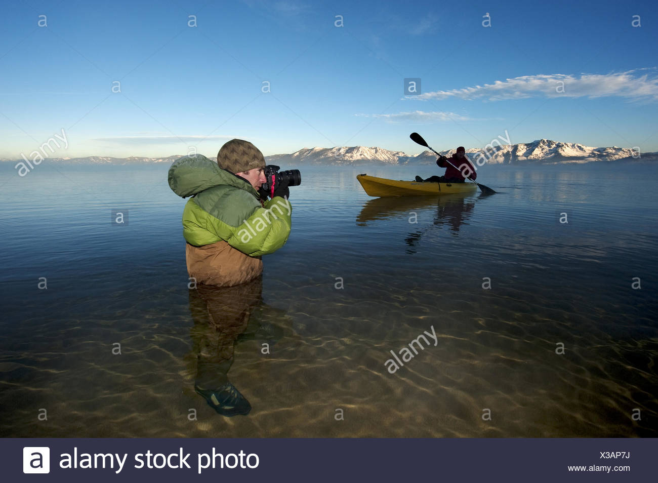 A photographer photographs a kayaker in Lake Tahoe. Stock Photo